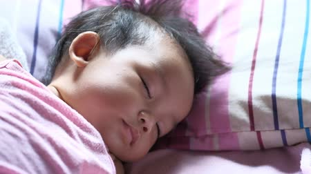 Beautiful Little Baby. Close up portrait of cute asian baby girl. Vídeos