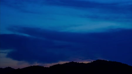 Sunset clouds time lapse.  Timelaps ofing fluffy clouds in the evening sky during sunset over tree.