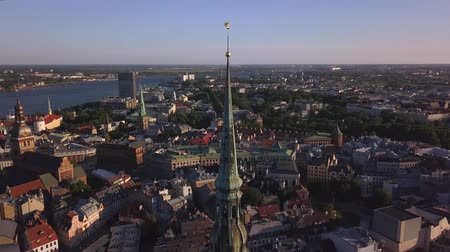 evangelical : Aerial view of the St. Peters Church, old town with Dome cathedral and Daugava river, Riga, Latvia Stock Footage
