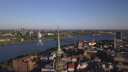 fiatal kis kakas : Aerial view of the St. Peters Church, old town with Dome cathedral and Daugava river, Riga, Latvia Stock mozgókép