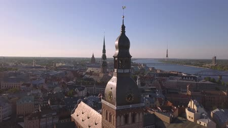 Aerial view on Dome cathedral in Old Riga City. Flight around the spire. Stock Footage