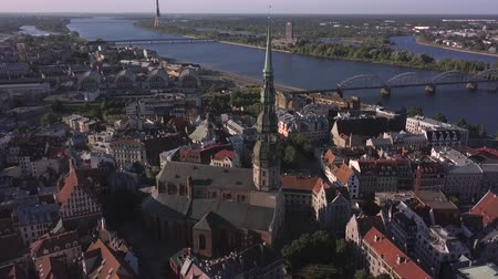 Aerial view of the St. Peters Church, old town and Daugava river, Riga, Latvia. Stock Footage