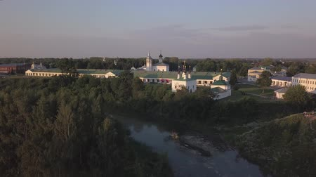 Flight over the river Kamenka and the shopping area in the ancient Russian city of Suzdal Stock Footage