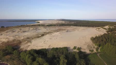 navy pier : Early morning aerial view of Parnidzio dune meeting sea in Curonian spit near Nida, Lithuania Stock Footage