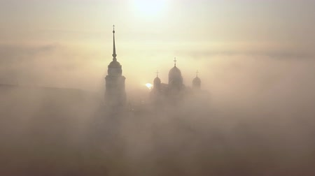 charles bridge : Foggy morning over the Assumption Cathedral in Vladimir. Clouds of fog fly over the cathedral. Birds eye view.