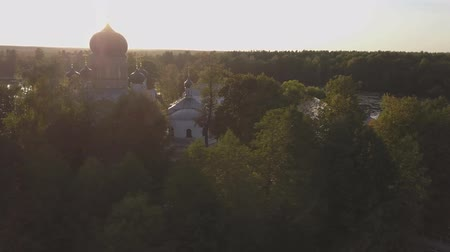 монастырь : The Holy-Vvedensky nunnery in the Vladimir region. On the island. Aerial view. Flight around monastery.