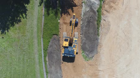 buldozer : Excavator loader working on a construction site. Aerial footage.
