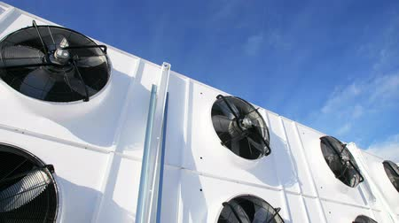 levegő : New Industrial large air conditioning fans on the background of blue sky Stock mozgókép