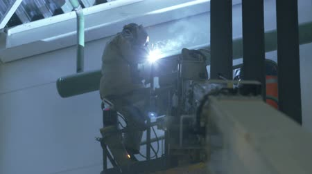 dach : welder on crane in an industrial warehouse