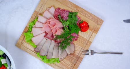 буфет : cold cuts on white tablecloths