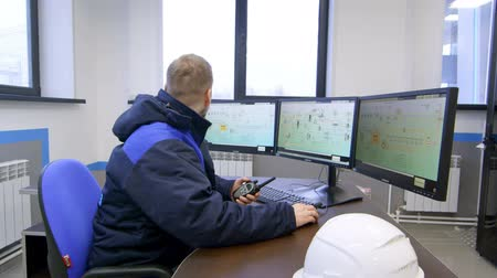 панель : engineer look at screens indicators then look at camera and smiles
