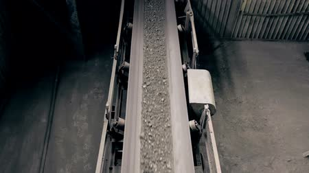 truck crane : ore move on conveyor in modern processing plant Stock Footage