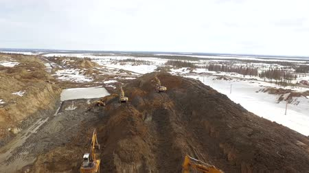 levelling : RUSSIA ST.PETERBURG- 28 FEBRUARY: Winter Aerial shot of new pipeline construction, excavators level the soil