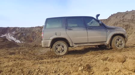 jumble : SUV driving on dirt road Stock Footage