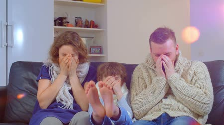 cold : a family of father, mother and the boy got sick, sneezing without end