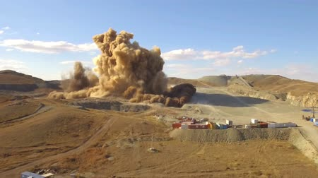 improvised : Aerial view A massive explosion rocks in desert. Dirt and metal shards into the air