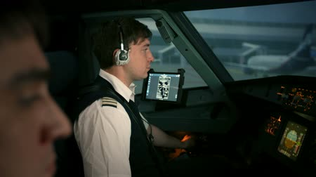 pilot in command : Beginning of journey. Modern passenger aircraft starts taxiing on ramp, apron, ruway of international aiport. Cabin crew at work Stock Footage