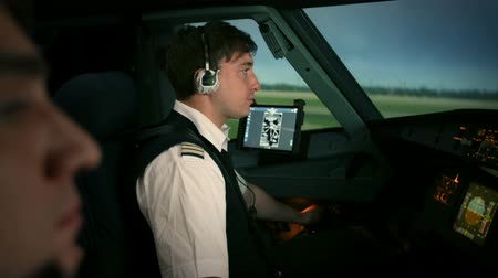 pilot in command : Airplane is taxiing on the runway of airport. Captain and co-pilot perform pre-flight procedure to be ready take off and departure.