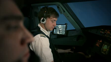 first officer : Captain and copilot in the flight deck of a passenger aircraft during the flight.