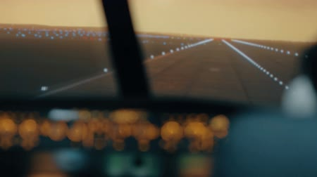factor : Modern passenger plane descent and landing. Sunset view from the cabin of modern plane to the Airport runway with lighting.