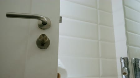toilet paper : Male hand behind door giving new toilet paper. Change finished toilet paper Stock Footage