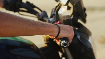 switching : Close-up of hand starting accelerating motorcycle.