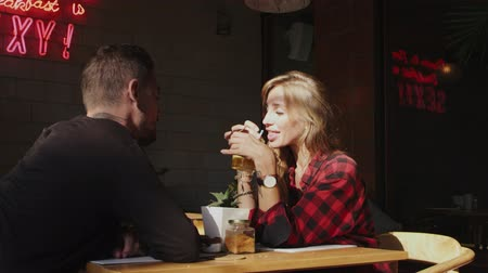 enticing : Young woman drinking cocktail tempting sitting in cafe Stock Footage