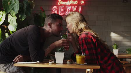 seduce : Lovers drinking one cocktail through different straws Stock Footage