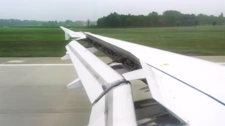 flap : View from passenger window of aircraft during landing on runway