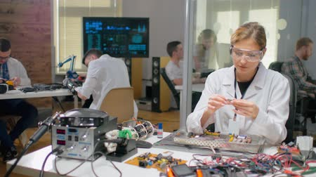 lab employee : Woman testing processor before installing it in computer Stock Footage