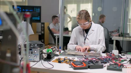 lab employee : circuit board technician engineer checking working controller microchip network. Stock Footage