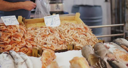 weighing machine : Seller in market weighs a portion of tiger shrimps Stock Footage