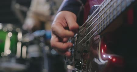 acoustical : Close up of male hand using finger-piece playing guitar Stock Footage