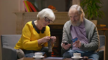 cash free : Retireg man doing hone shopping online with old age woman. Stock Footage