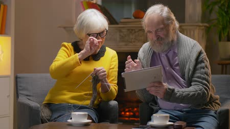 listener : Grandparents talking to grandchildren on tablet computer. Stock Footage