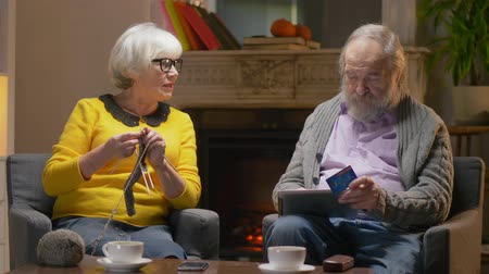 cash free : Elderly stylish man and pretty elderly woman paying by credit card Stock Footage