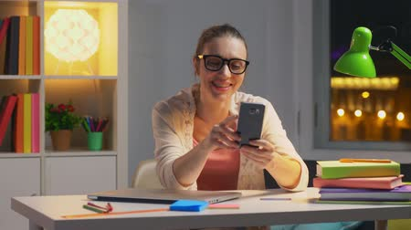 easily : Happy smiling woman talking on video chat with her parents Stock Footage