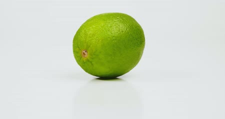 césar : Fresh lime fruit isolated on whate background Stock Footage
