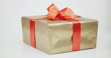 picture box : Present wrapped with golden paper and tied red ribbon bow