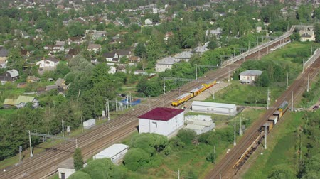 Flight over small railway station in rural town on summer day Stock mozgókép
