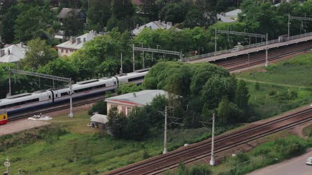 camera rotation : Russia - October, 2018. High speed passenger train Sapsan passing by train station in countryside