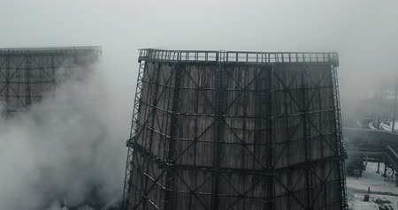 metallurgical plant : Aerial view - close up - cooling towers at metallurgical plant Stock Footage