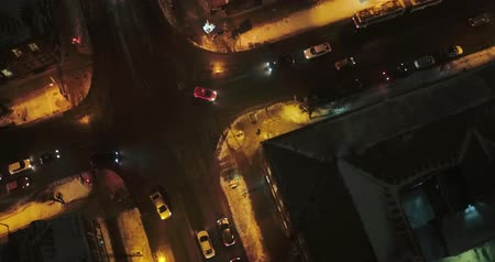 Aerial view - view of the night streets the movement of cars with the headlights