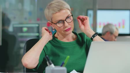 Adult successful businesswoman stretching the neck Stock mozgókép
