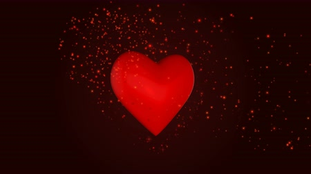 Heart with glowing particles on the dark red background Filmati Stock