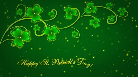 Happy St. Patricks Day with shamrocks on the green background