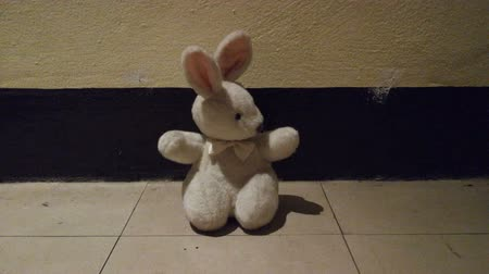 perverso : The creepy rabbit doll in low light room.