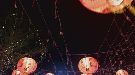 ano novo chinês : The  Chinese lanterns in night market Thailand footage. Vídeos