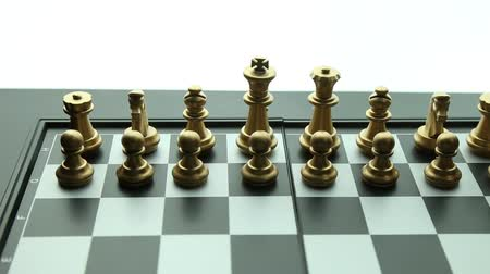 derrota : The gold and silver chess on board close up footage.