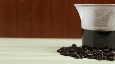 brew coffee : The coffee drip cup on white table  for background footage camera movement.